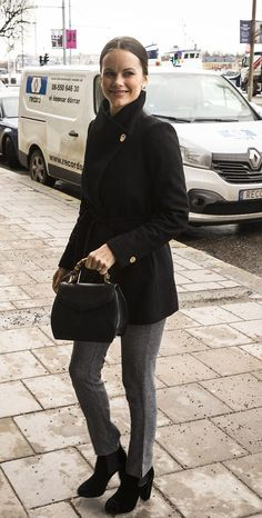 Princess Sofia of Sweden kept things casual for the lunch time event as she wore a black pea coat with gold buttons, grey trousers and black boots.