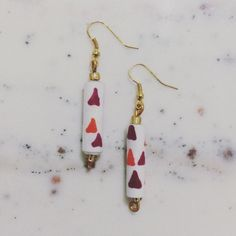 Magenta & Orange Triangle Paper Bead Earrings Show off your personal style with these unique earrings, handcrafted using paper & glass beads! To create these lightweight accessories, I covered paper strips with a vibrant design & hand-rolled each bead. They have been coated with water-resistant (NOT water-proof) varnish. A rain shower shouldn't damage the earrings. However, the beads should not be submerged in water (in a pool, for example). There are small glass beads at the top & bottom…