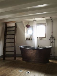 this is where its at.  Looks like a copper tub, rain shower, peeking out of the port side hatch...