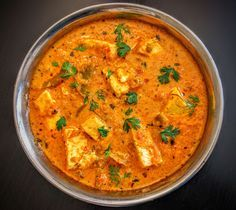 Kadai Paneer is a popular Indian curry made of Paneer cubes cooked in a spicy & aromatic onion tomato gravy and flavored with spices.