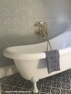 The elegant Large Maple design was used to create this pressed metal feature wall. Tiles and linen suit the theme so well. Bathroom Barn Door, Art Deco Bathroom, New Bathroom Ideas, Bathroom Sink Vanity, Bathroom Inspiration, Kitchen Ideas, Bathroom Feature Wall, Bathroom Wall, Tin Tiles