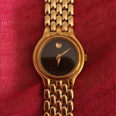 Yellow gold ladies Movado watch. Museum Classic ladies Movado watch. Yellow gold finish with black dial. Stainless steel. Excellent condition with the box. Watch is in working condition just needs a new battery. Movado Accessories Watches
