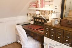 Cute study space! I love all the scrapbook paper covered boxes. Her sewing space is adorable, too.