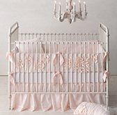 Bedskirt.  RH Baby & Child's Washed Appliquéd Fleur Nursery Bedding Collection:A texture-rich composition of gathers and blooms, created using ruching and appliqués on airy cotton voile, gives our bedding a decidedly feminine feel.