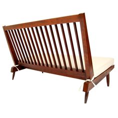 Nakashima Studio Slat-Back Settee in Walnut   From a unique collection of antique and modern settees at https://www.1stdibs.com/furniture/seating/settees/