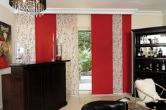 Panel blind is the most innovative shading solution for larger windows and patio doors. This blind also looks stunning as a stylish room divider. Here in red colour and cream and red pattern. Rimini Blind's panel blind is available in a diverse range of designs and fabrics including, sheer voiles and faux suede, all of which will enhance the decor of any room.