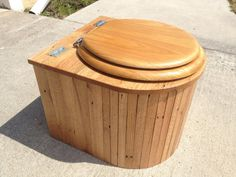 "Composting Toilet ""The Cabin Can"" Oak on Etsy, $179.00. Nice looking composting toilet"