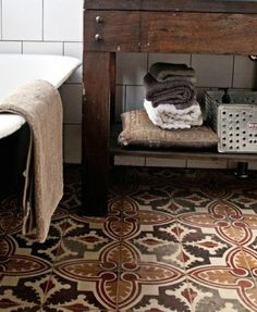 Just adore this kind of old tile! One of the houses my family lived in when I was a kid had a tiled floor very much like the one pictured here, and not just in the bathroom.