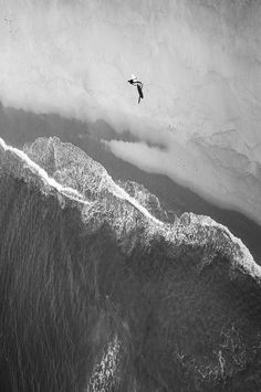 Aerial shot of a surfer on a beach