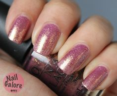 """OPI """"RALLY PRETTY PINK"""" nail polish. Pink color with gold highlights."""