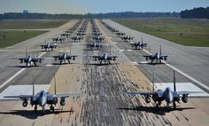 "70 F-15E Strike Eagles of the 4th Fighter Wing perform an ""Elephant Walk"""