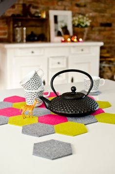 DIY felt hexagon coaster/place mat! Love the colour palette