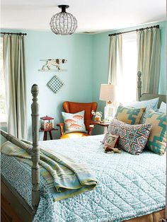 Patterned pillows are an inexpensive way to style a bed. More of our favorite real-life bedrooms: http://www.bhg.com/rooms/bedroom/master-bedroom/25-of-our-favorite-real-life-bedrooms-/?socsrc=bhgpin051913patternpillowsbedroom
