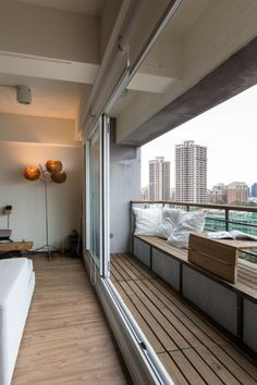Apartment balcony. Apartment balcony's are usually small but installing sliding windows would open up the area turning the living into a temporary balcony.