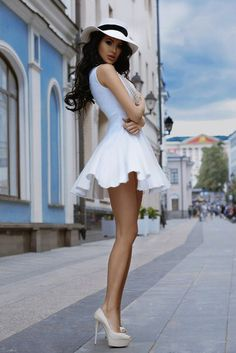 white dress hat long legs feeling good outdoors fresh air