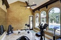 Exercise Room with a great view of pool, plus a vaulted ceiling with light cove...