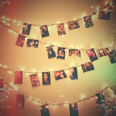 Pictures on a light string. Definitely doing this at our next house!!! So so cute
