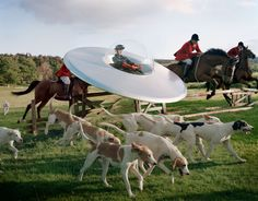 Kinga Rajzak in flying saucer with members of the West Percy Hunt by Tim Walker