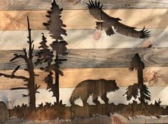 DESCRIPTION This is a completely one of a kind piece. There is no other like it out there. It features a silhouette cut out of a bear, eagle, trees and snags. It is very detailed down to every element of design. The bear and eagle silhouette in the nature gives it a very
