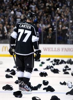 Jeff Carter of the Los Angeles Kings skates as hats fill the ice in recognition of his natural hat trick for a lead over the Nashville Predators Hockey Mom, Hockey Teams, Hockey Players, Ice Hockey, Hockey Girls, Hockey Stuff, Wells, Jeff Carter, La Kings Hockey
