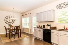 Baltic Plan Kitchen and Dining Space with Grey Painted Cabinets