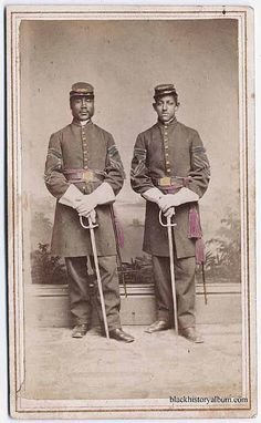 Full length double portrait, two African American Union Army soldiers with swords, standing [hand tinted]. Randolph L. Simpson African-American collection. Beinecke Rare Book and Manuscript Library, Yale University.  Vintage African American photography courtesy of Black History Album, The Way We Were.  Follow Us On Twitter @blackhistoryalb