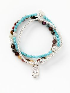 Set of three sterling silver, multicolor semi-precious gemstone, and turquoise bead stretch bracelets with sterling silver owl charm