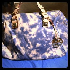 Michael Kors handbag Michael Kors blue and beige tie dye large bag. Has gold accents. Soft leather. In excellent condition never used. ready for a new owner. Kept in dust bag. Michael Kors Bags