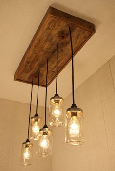 Beautifully Crafted Farmhouse Chandelier, Mason Jar Lighting, With Reclaimed Wood and 5 Pendants, homedecorationliv. deals in unique lighting system to make your best interior kitchen decoration like kitchen lighti. Small Kitchen Lighting, Kitchen Lighting Fixtures, Light Fixtures, Country Kitchen Lighting, Ceiling Fixtures, Mason Jar Chandelier, Mason Jar Lighting, Mason Jar Light Fixture, Mason Jar Pendant Light