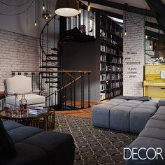 Tons sóbrios e estilo industrial conferem charme a este estar. Os livros ao fundo descontraem enquanto os pêndulos e a escada em espiral são o destaque.