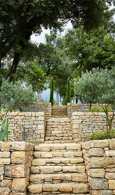Pierre Yovanovitch converted a former farm of Château de Fabrègues into a guest house. Pierre Yovanovitch, Stone Wall Design, French Exterior, Stone Retaining Wall, Garden Stairs, Hillside Landscaping, Mediterranean Garden, Stone Houses, Garden Paths