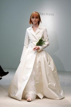 love the idea of wearing a trench/pea coat over your wedding dress to fight the cold