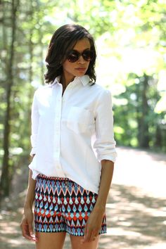 Bold patterned shorts and a white button down