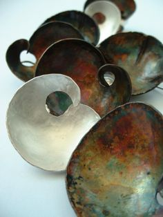 Ann Bruford - Wave and Wort earrings in patinated copper and sterling silver
