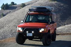holy shitballs.....custom one off Land Rover Discovery II.....rear half of suv roof cut off after damage and then modified into a pickup with custom rollbar, canvas top, and so much more. this thing is amazing. found on craigslist. If i had $33g's layin around, this would be in my driveway NOW.