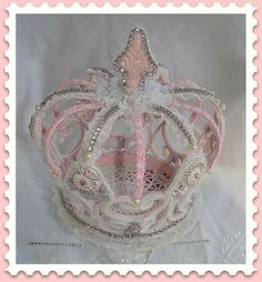 I LOVE this one.  Called Queen's Crown By Treasured Heirlooms.  see www.eleganceandwhimsy.com