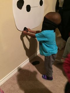 Pin the eyes on BayMax game at my little guy's 3rd birthday party. Big Hero 6!
