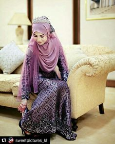 Purple songket outfit and hijab for wedding... photo by sweetpictures_kl