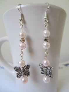 Butterfly and Glass Pearl Earrings by beausbitsandbobs on Etsy, £4.20