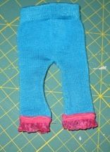 Time for another Guest Post from Peggy. She has a real knack for making cute doll clothes out of ladies socks and this week she shows how easy it is to make a pair of Capri pants for your 18 inch doll.
