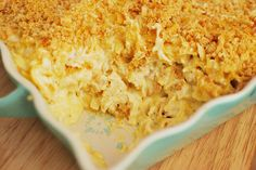 Cheesy Chicken Noodle   1 pound chicken breasts, cooked and diced  1 pound wide egg noodles, cooked  24 ounce container sour cream  2 (10 3/4 ounce) cans cream of chicken soup  2 cups cheddar cheese, shredded  2 cups mozzarella cheese, shredded  1 sleeve Ritz crackers, crushed  1/4 cup butter, melted