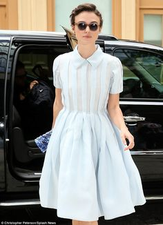 So chic: Keira Knightley puts her sartorial foot forward in a pleated shirt dress and retro rounded sunglasses in New York