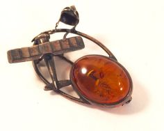 A personal favorite from my Etsy shop https://www.etsy.com/listing/250379823/sterling-silver-brooch-with-baltic-amber