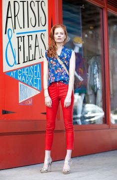 red pants and bright printed top