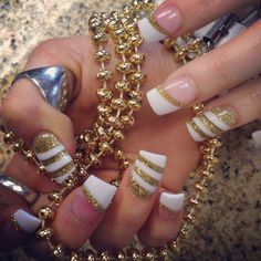Sexy White and gold striped solar nails