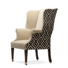 An unusual wing chair, the original dates back to the 19th Century, but the style is very Georgian. A very neatly presented wing chair that has wide appeal. Straight tapering legs on a flush fitted socket castor.  The look of this chair can be changed hugely by the clever use of fabric.  Despite the period design, it can look quite modern in a plain fabric. The chair is quite wide and the arms are perfectly positioned for your elbows