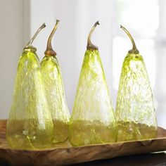 Hand-Blown Glass Pear - An iridescent stem sits atop these oversized hand-blown, dimpled pears, adding a masterly decorative flourish. Each unique translucent pear reflects light and adds graceful punctuation to mantle, table, or shelf. $52
