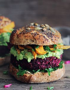 Black bean burgers with herbed avocado sauce from The Awesome Green.