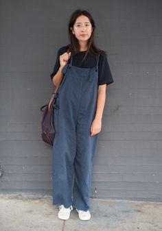 """Julia, 22""""I'm wearing an Our Legacy tee with these new workers overalls I got from a really funny store in New York, and New Balance shoes. My style is inspired by menswear. I'm usually wearing a baggy pant and a t-shirt. I always have on men's clothing, I wish more women would do the same thing!""""Sep 3, 2015 ∙ Mission Dolores"""