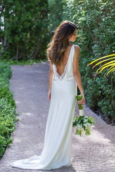 Elegant chic low back wedding dress: Photography : Elizabeth Medina Read More on SMP: http://www.stylemepretty.com/destination-weddings/mexico-weddings/2016/10/13/elegant-chic-mexican-wedding/